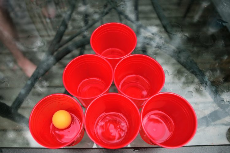 Solo cups, ping pong ball, table